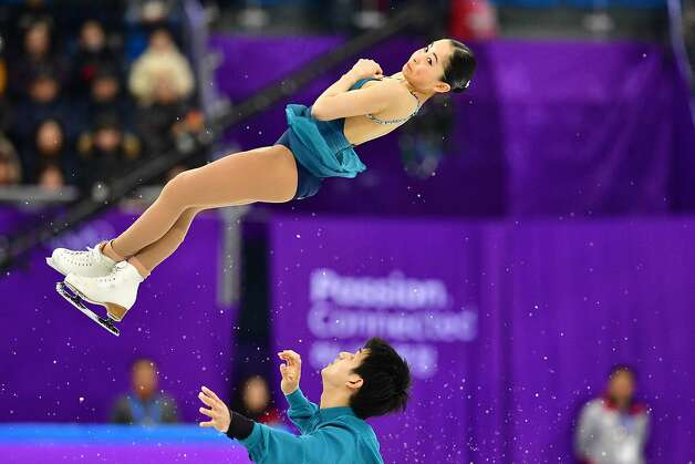 Japan's Miu Suzaki (top) and Japan's Ryuichi Kihara compete in the figure skating team event pair skating short program during the Pyeongchang 2018 Winter Olympic Games at the Gangneung Ice Arena in Gangneung on February 9, 2018. Photo: MLADEN ANTONOV, AFP/Getty Images