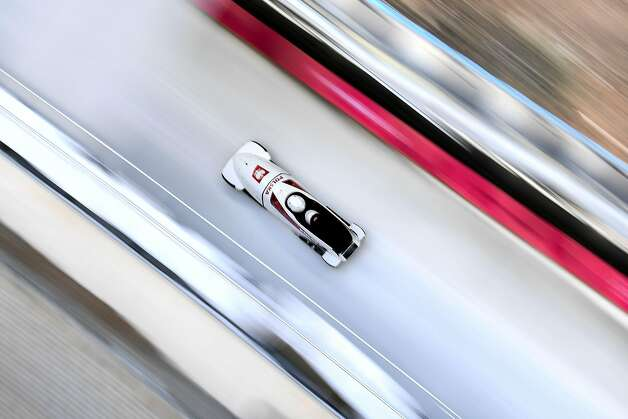 Poland's team leader and driver Mateusz Luty takes a turn in the first men's unofficial bobsleigh training session at the Olympic Sliding Centre, during the Pyeongchang 2018 Winter Olympic Games in Pyeongchang on February 7, 2018.  Photo: KIRILL KUDRYAVTSEV, AFP/Getty Images