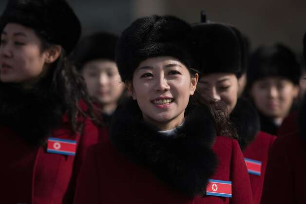 North Korean cheerleaders arrive at a rest stop as their bus convoy carrying a 280-member delegation on its way to the 2018 Pyeongchang winter Olympic games, makes its way past Gapyeong on February 7, 2018. More than 200 young North Korean women arrived in South Korea to root for athletes from both sides of the peninsula at the Winter Olympics.  Photo: ED JONES, AFP/Getty Images