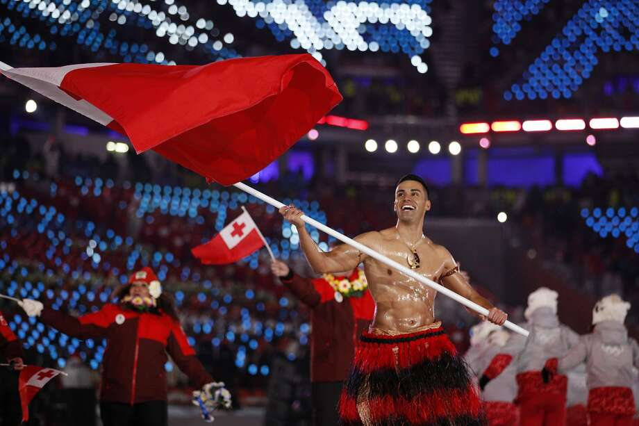 Pita Taufatofua carries the flag of Tonga during the opening ceremony of the 2018 Winter Olympics in Pyeongchang, South Korea, Friday, Feb. 9, 2018. (AP Photo/Jae C. Hong) Photo: Jae C. Hong, Associated Press