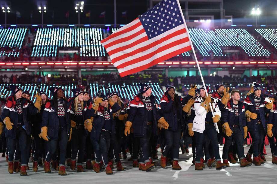 TOPSHOT - USA's delegation and flagbearer Erin Hamlin parade during the opening ceremony of the Pyeongchang 2018 Winter Olympic Games at the Pyeongchang Stadium on February 9, 2018. / AFP PHOTO / Mark RALSTONMARK RALSTON/AFP/Getty Images Photo: MARK RALSTON, AFP/Getty Images / AFP or licensors