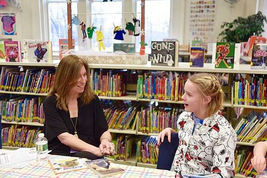 "Shea Ward, a Holmes School fourth-grader, meets Lauren Tarshis, author of the popular ""I Survived"" series. Photo: Contributed / Contributed Photo"
