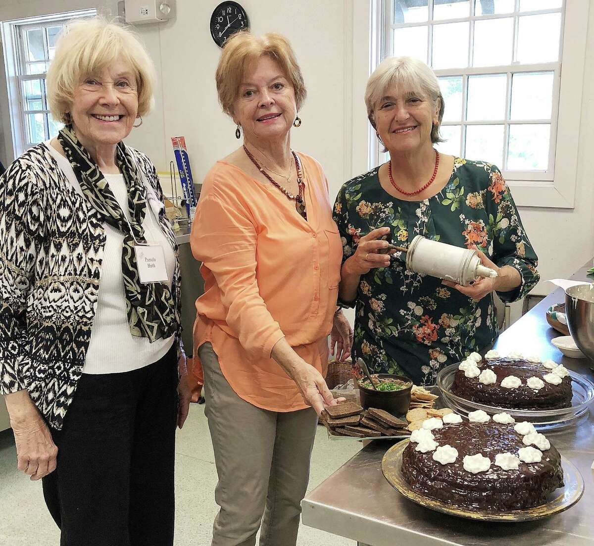 Pamela Huth, left, Ruth Morgan and Liz Orteig, members of the Eating and Tasting Society of the Encore Club of New Canaan, prepare sachertortes for their monthly luncheon.