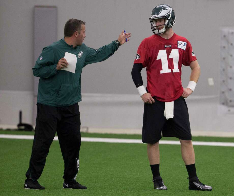 PHILADELPHIA, PA - MAY 13: Quarterbacks coach John DeFilippo of the Philadelphia Eagles talks to Carson Wentz #11 during rookie camp at the NovaCare Complex on May 13, 2016 in Philadelphia, Pennsylvania. Photo: Mitchell Leff, Getty Images / 2016 Mitchell Leff