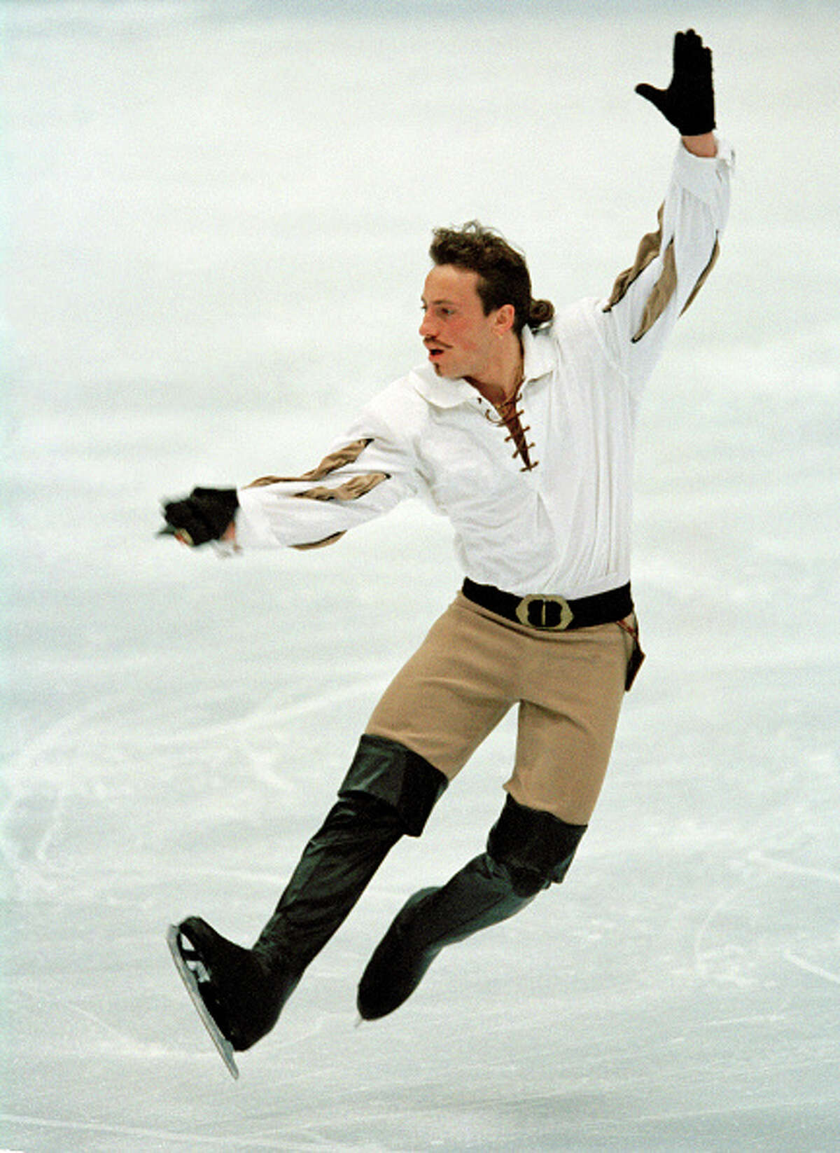 Philippe Candeloro of France, bronze medallist in the men's figure skating event, in action during the Winter Olympic Games in Nagano, Japan, circa February 1998. (Photo by Eileen Langsley/Popperfoto/Getty Images)