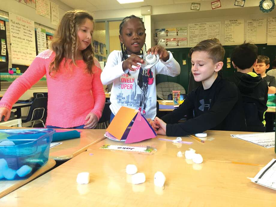N.O. Nelson second graders Joy Gray, Kayli McDonald, and Jake Rosenberger, from left, work on their hibernation station. Photo: Julia Biggs • Jbiggs.edwi@gmail.com