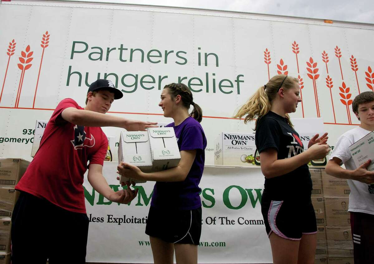 Houston-area teens unload 30,000 pounds of food donated from Newman's Own after their church pastor won a challenge on the popular television program