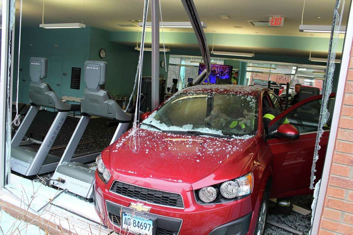 An elderly female driver drove through two windows at an upscale apartment complex at 1 Glover Ave. on Friday, Feb. 9.