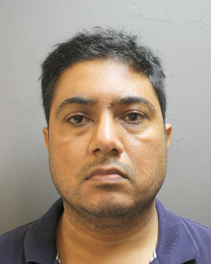 FILE - A head shot of Aamir Khan at the Harris County Jail on Feb. 8, 2018. Khan is accused of sexually assaulting an underage employee in Houston and fleeing to Canada with his family after the deed.