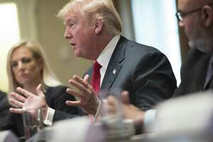 President Donald Trump hosts a roundtable discussion on gang violence at the White House in Washington, Feb. 6, 2018. Trump, who has taken credit for a rising stock market as a measure of his own success, complained on Twitter Wednesday that good (great) news in the economy led to an abrupt decline in stock prices, his first comments about the market since its sharp drop earlier in the week.