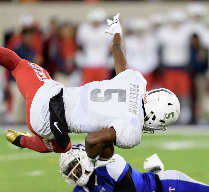 Jalen Preston (5) of the Manvel Mavericks is upended in the first half by a Temple Wildcats player in a high school football game on Friday, December 8, 2017 at Blackshear Field at Prairie View A&M University.