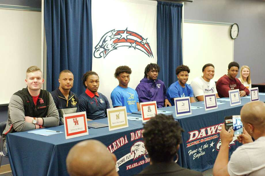 Dawson athletes signing national letters of intent Wednesday were Spencer Wells (football, University of Houston), Bryce Victorian (football, Navy), Bam Smith (football, Arizona), Jacolby Shelton (football, Texas A&-Kingsville), Eddie Scott III (football, Tarleton State), Malcolm Kitt-Denton (football, Kilgore College), Payne He'bert (football, Northwestern University), Isaiah Chance (football, Texas Southern  University), Mackenzie Ostrom (soccer, University of Tennessee). Photo: Kirk Sides / © 2018 Kirk Sides / Houston Chronicle