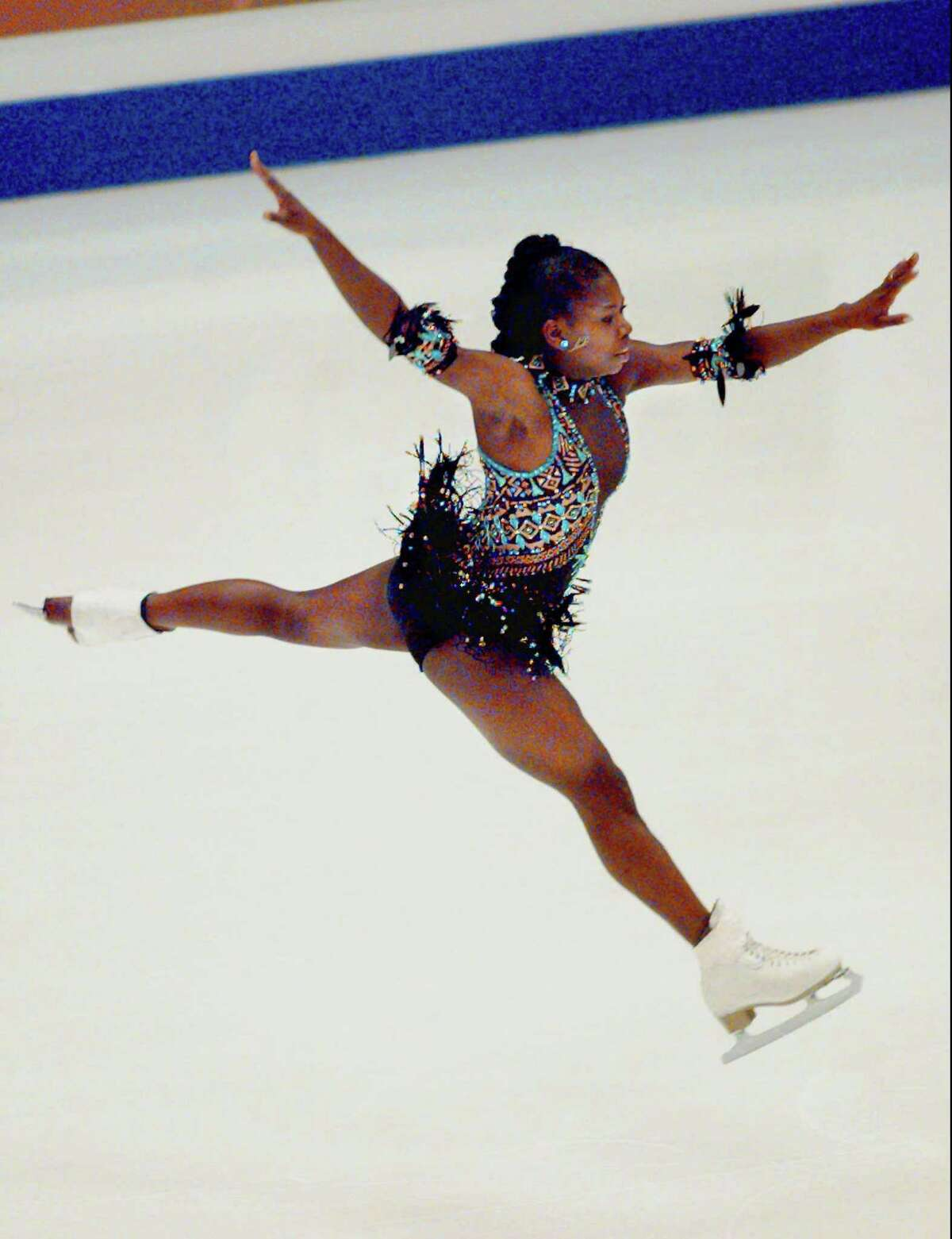 Surya Bonaly of France performs during her short program at the 1998 European Figure Skating Championships.