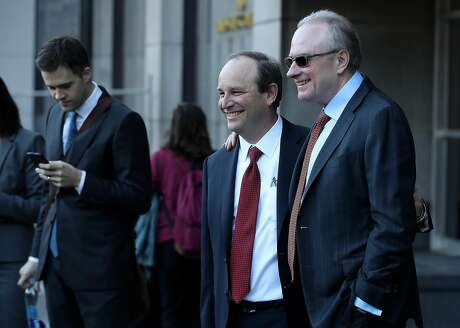 SAN FRANCISCO, CA - FEBRUARY 09:  Uber attorney Bill Carmody (R) and Waymo attorney Charles Verhoeven (L) pose for a photo outside of the Phillip Burton Federal Building after the Waymo-Uber technology theft trial was dismissed on February 9, 2018 in San Francisco, California. The Waymo-Uber technology theft trial was settled early Friday with Uber agreeing not to use Waymo's self-driving car technology and also agreed to paying out a .34 percent equity stake, valued at $245 million.  (Photo by Justin Sullivan/Getty Images)