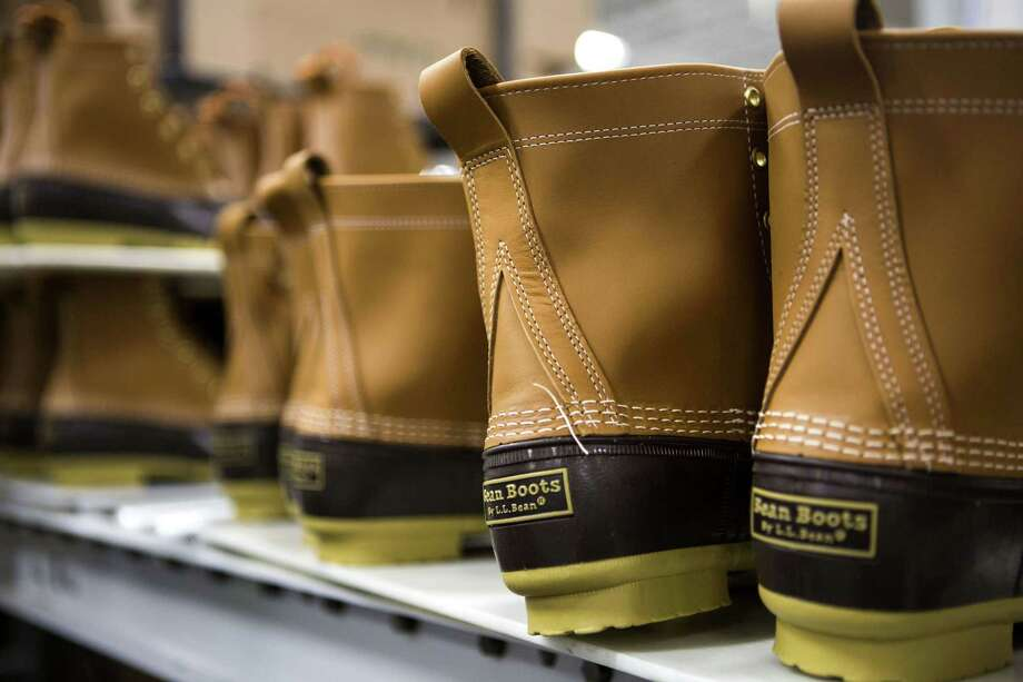 Finished boots sit on a conveyor belt before being packaged at the L.L. Bean Inc. manufacturing facility in Brunswick, Maine, on Sept. 9, 2015. Photo: Bloomberg Photo By Shiho Fukada. / © 2015 Bloomberg Finance LP