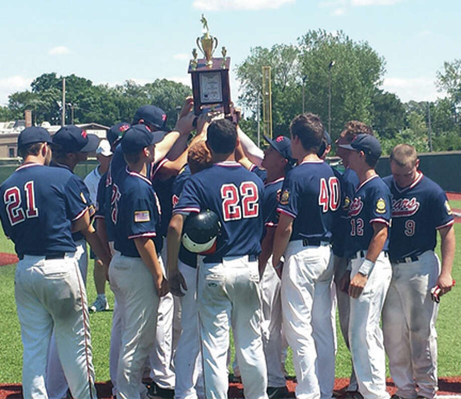 Members of the Metro East Bears hoist the trophy for Senior Legion state runner-up on Saturday at Lee Pfund Stadium in Carol Stream. Photo: Louie Korac / For The Telegraph