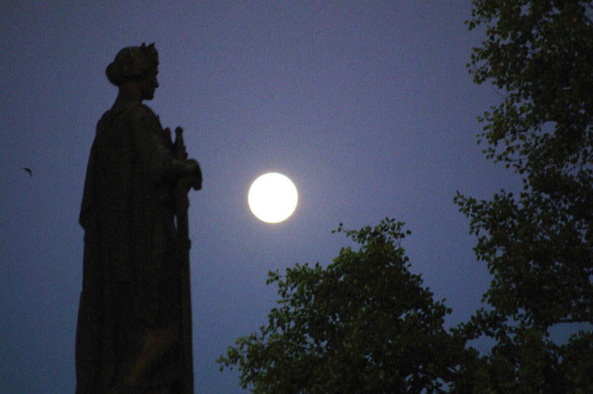 David Blanchette   Reader photo A statue in the park in downtown Jacksonville keeps a watchful eye on the moon.