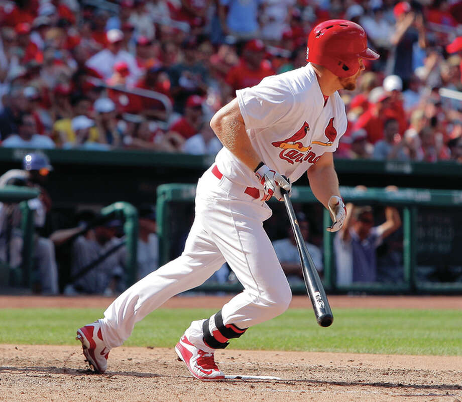 The Cardinals' Brandon Moss, recently acquired in a trade with Cleveland, hits a walkoff single to drive in the winning run during the ninth inning of the Cards' win over the Colorado Rockies on Sunday at Busch Stadium. Photo: Scott Kane / Associated Press