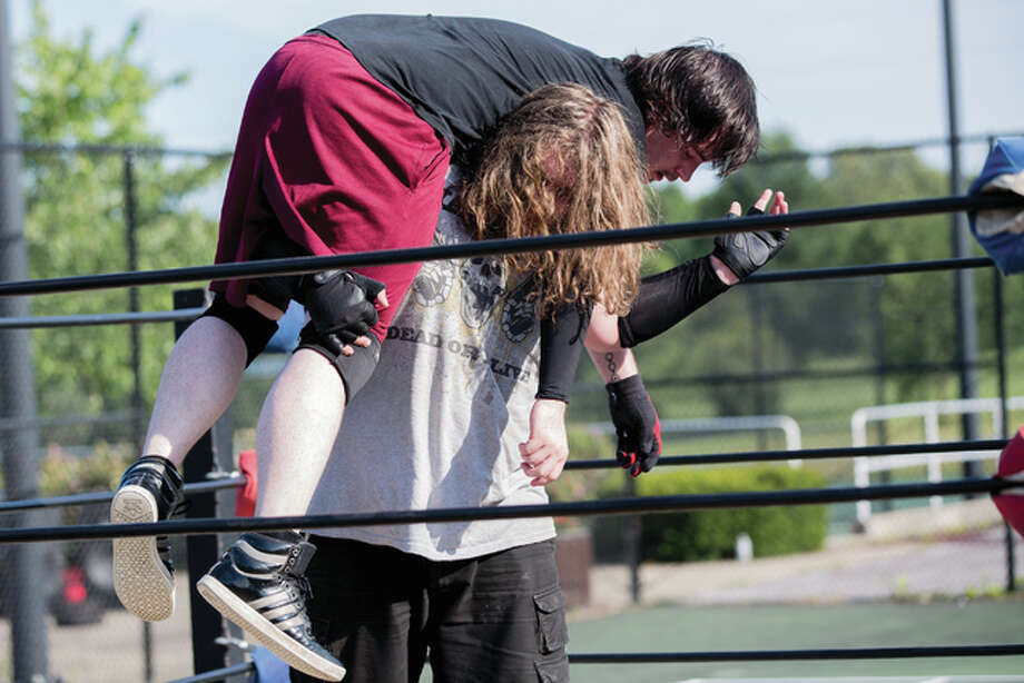 The Cottage Hills Wrestling Alliance took over the Gordon Moore Park tennis courts located at the back of the park and turned it into their version of Madison Square Garden — the famous New York City venue. A wrestling ring was placed in the middle of the courts as spectators filled the park to watch the show. Photo: Dan Cruz | For The Telegraph