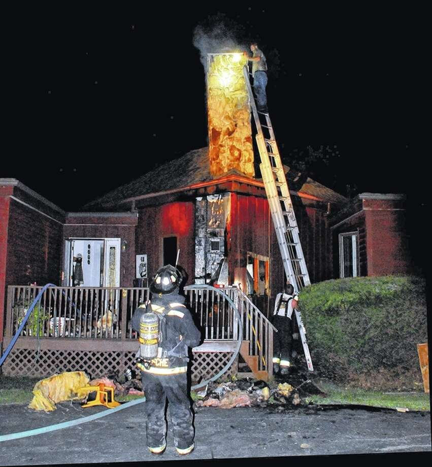 Robert Daniel   Journal-Courier Members of the Virginia Volunteer Fire Department fight a house fire Sunday morning on Hickory Cross Road near Virginia. There were no injuries, and damage to the house was kept to a minimum, according to officials. Virginia firefighters, MECCA Ambulance, Cass County deputies and Virginia police officers were on the scene about two and a half hours.