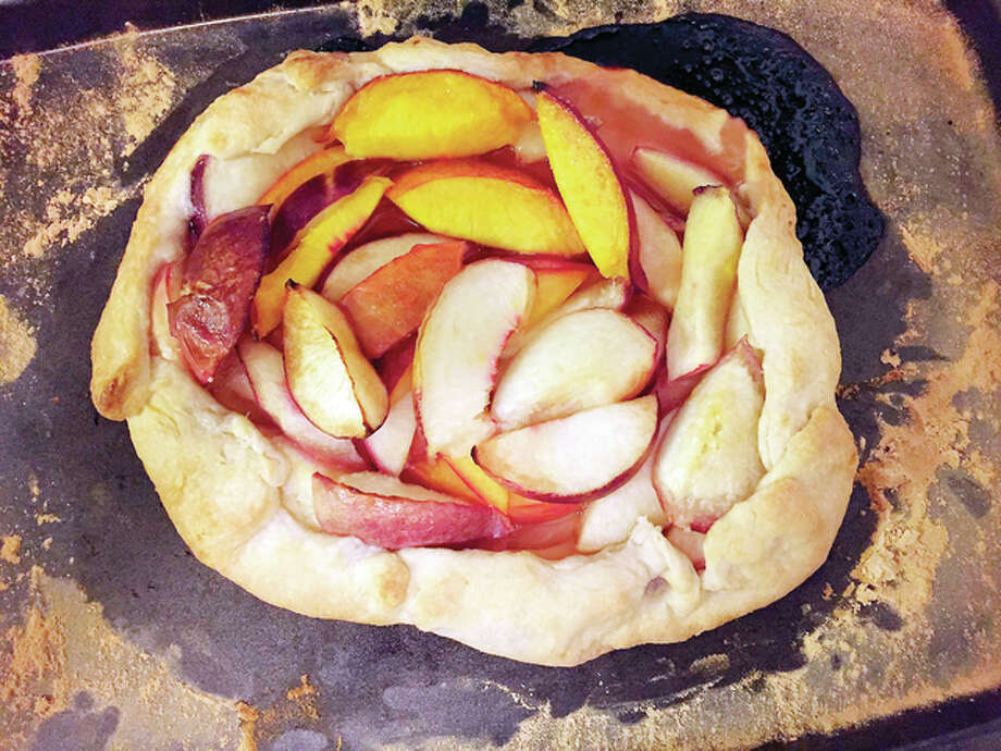 Making a peach and nectarine tart is a fairly simple process with tasty results. Photo: Hannah Schwarz | NPittsburgh Post-Gazette | TNS
