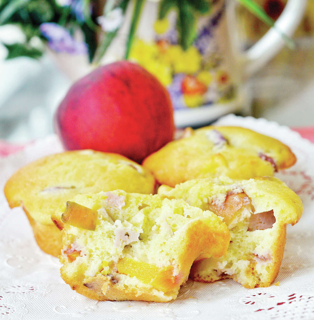 Peach muffins add a touch of sweetness to breakfast, though it's not limited to the first meal of the day.