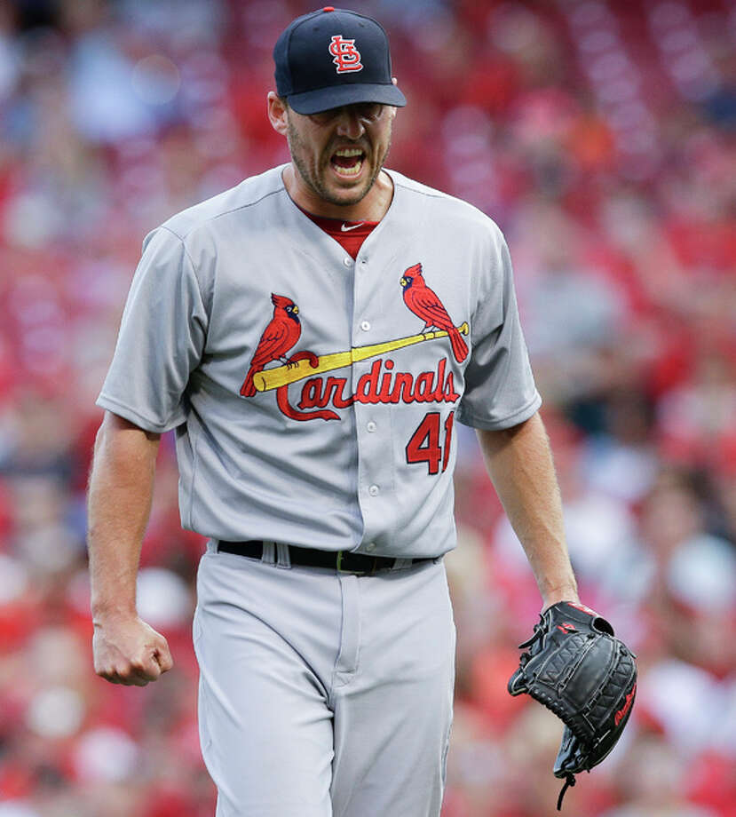 Cardinals starting pitcher John Lackey reacts after giving up three runs to the Cincinnati Reds during the first inning Tuesday night in Cincinnati. Photo: AP