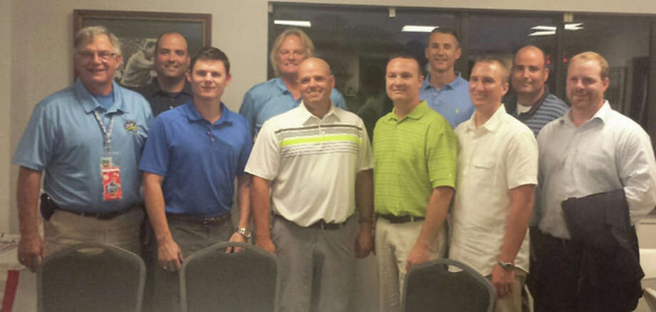 Members of the Edwardsville Post 199 Legion team that won the national championship in 1998 that were on hand for Tuesday's Great Lakes Regional banquet at Spencer T. Olin golf course included (back row, from left) Ben Hutton, manager Ken Schaake, Dave Crouthers and James Hutton, (front row, from left) coach Steve Haug, Chad Opel, Nick Seibert, Brad Grotefendt, Kory Kuba and Todd Haug. Photo: Louie Korac / For The Telegraph