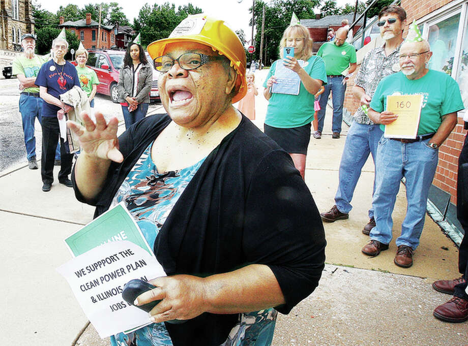 The Rev. Norma Patterson fires up a crowd of about 50 protesters outside of the Alton office on State Sen. Bill Haine on Henry Street in Alton Wednesday as the group gathered to support the Illinois Clean Jobs Bill. The bill, according to supporters, would help create 32,000 new jobs through a variety of means including increasing the share of power used in Illinois from wind and solar sources. After finishing at Haine's office, the group marched up Henry Street to the office of State Rep. Dan Beiser.