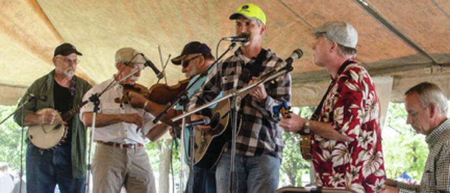 Known for their intricate instrumental interplay, the Mound City Slickers include Sean Ruprecht-Belt, performing on banjo and ukulele, Bob Clark on banjo, Roy Farwell on guitar and banjo, Rich Egan on piano and Bill Stewart on fiddle. Photo: For The Telegraph