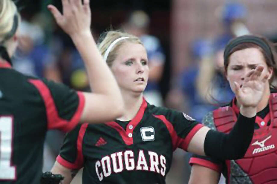 Haley Chambers, shown greeting teammates while coming off the field during lasts season's OVC Tournament at Cougar Field in Edwardsville, will not return for her senior season with the Cougars. The OVC Pitcher of the Year as a junior in 2015 has left the team for personal reasons. Photo: SIUE Athletics
