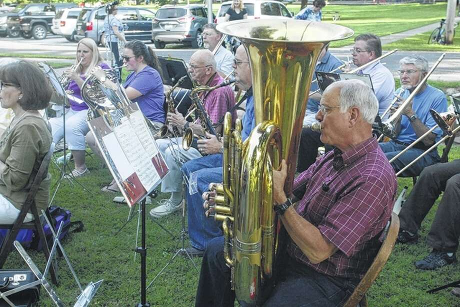 The Community Summer Band plays Thursday evening at the ice cream social on the front lawn of the Gov. Duncan Mansion in Jacksonville. Proceeds from the annual event benefit the Rev. James Caldwell Chapter of the National Society of the Daughters of the American Revolution, which owns and maintains the Duncan Mansion. Photo: Greg Olson | Journal-Courier