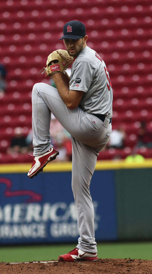 Cardinals pitcher Michael Wacha works against the Reds in the first inning Thursday in Cincinnati. Photo: Associated Press