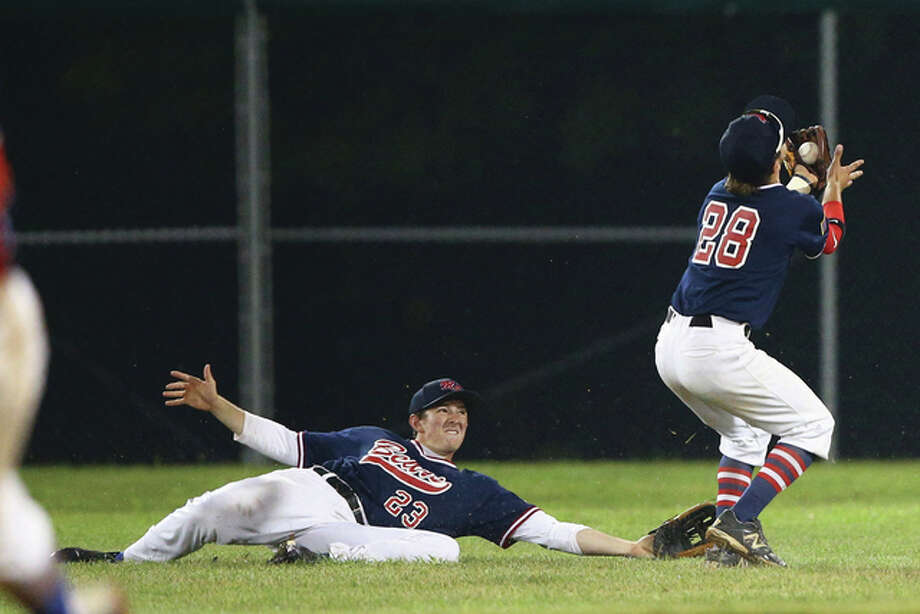 Metro East's second baseman Mitchell Krebs (right) catches a fly ball hit to shallow center field in front of the dive of center fielder Matt Zielonko during the second inning of the Great Lakes Regional Tournament at Lloyd Hopkins Field in Alton. Photo: Billy Hurst / For The Telegraph