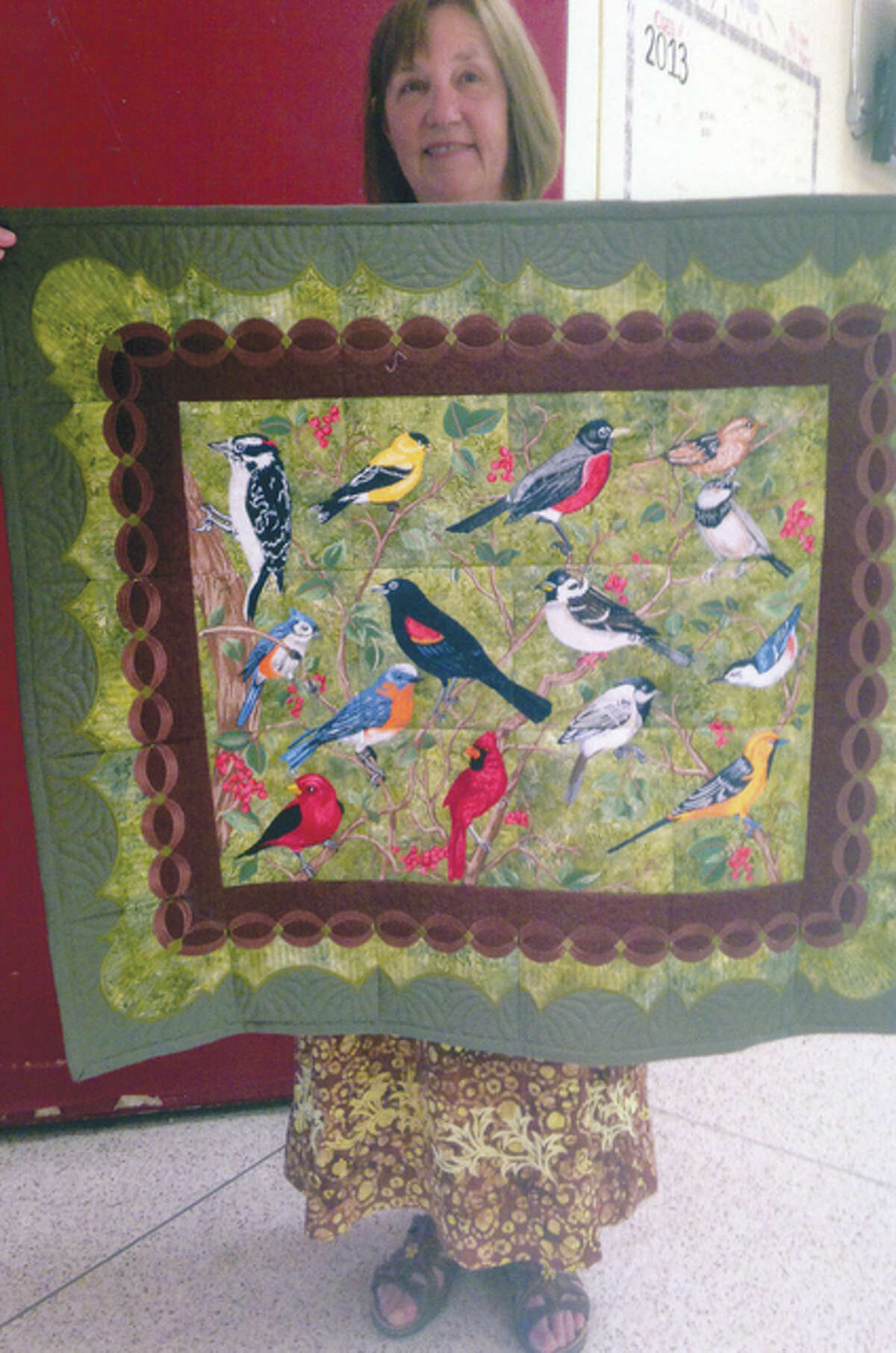 """Photo provided Donna Fezler of Jacksonville received the Viewers' Choice Award for her wall hanging titled """"Birds"""" during this year's River Country Quilt Show, which took place in July at Jacksonville High School. Her wall hanging will be displayed during the 2016 show."""