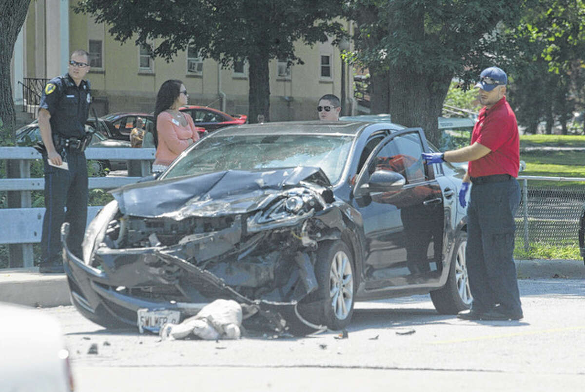 At least one person was injured around noon Friday in a two-vehicle accident at South Diamond Avenue and Hoagland Boulevard. Nancy K. Rogers, 61, of Winchester was treated and released from Passavant Area Hospital following the accident. Sara D. Walker, 24, of 1585 Trinity Ave., Bluffs, was cited for following to close. No other injuries were reported.