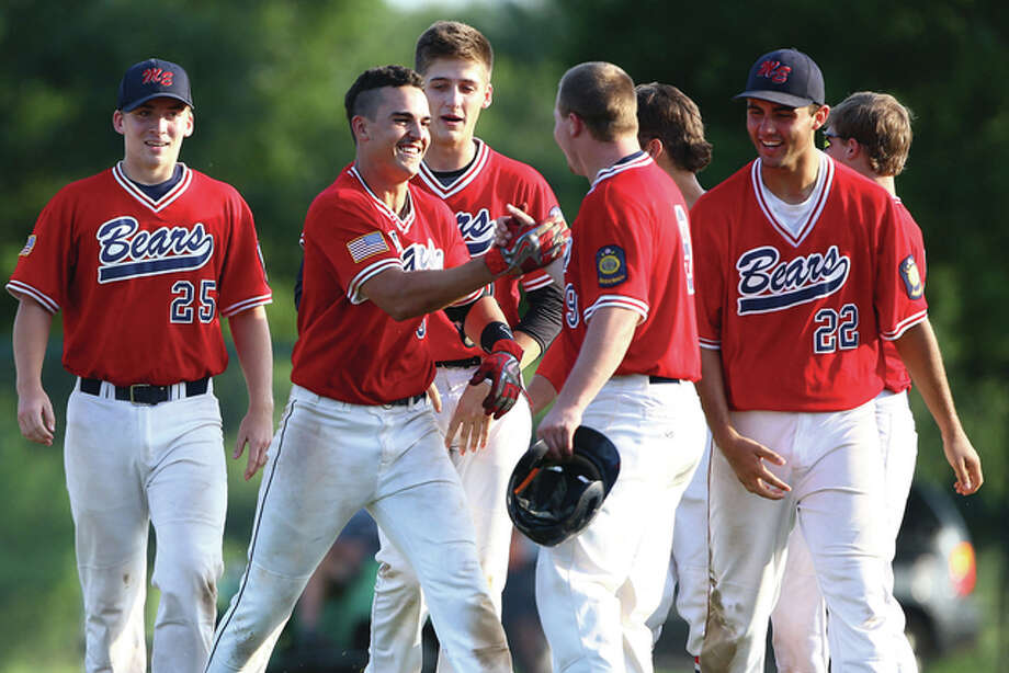 Metro East's Drake Hampton (second from left) celebrates with teammates after hitting a walk-off game winning single to lift the Bears to a 4-3 victory over Plover, Wis., on Friday in the Great Lakes Regional Tournament at Lloyd Hopkins Field in Alton. Photo: Billy Hurst / For The Telegraph