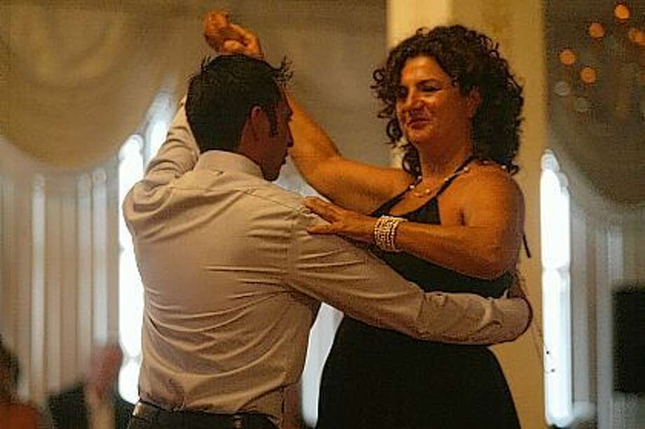 Maralee Hankins (right) dances with Julio Barrenzuela on Friday during the Pilot Club's annual Dancing with the Stars event. Photo: Samantha McDaniel-Ogletree | Journal-Courier