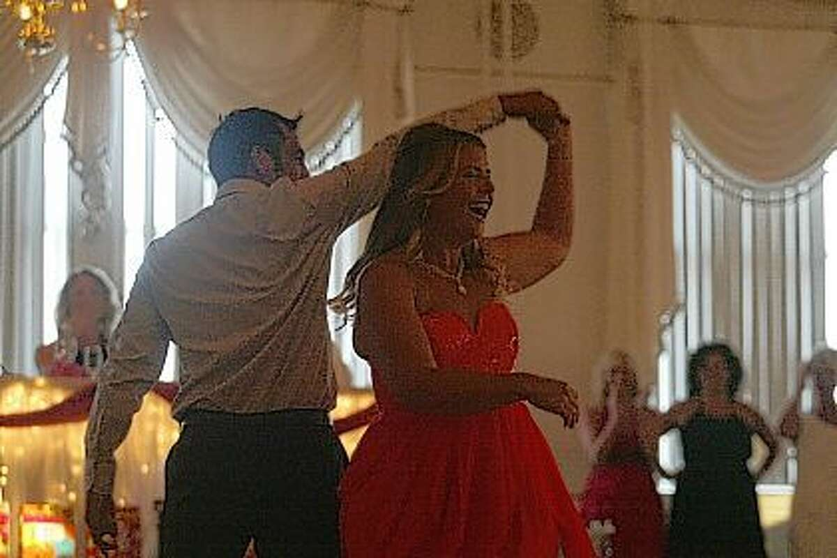 Sarah Van Aken (right) dances with Julio Barrenzuela on Friday during the Pilot Club's annual Dancing with the Stars.