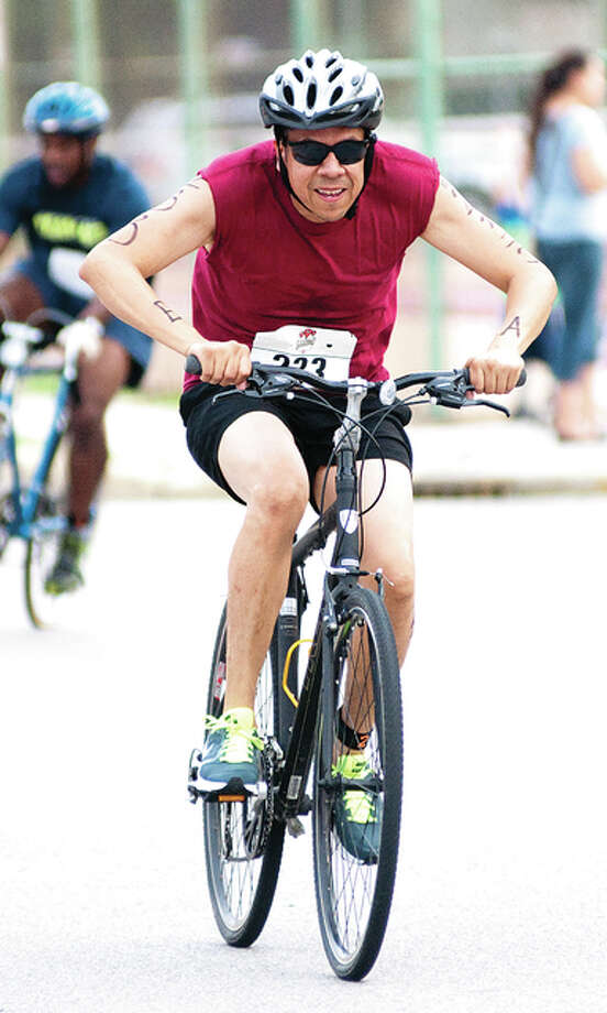 The triathletes also had to bike for 12 miles, traversing a two-mile radius on neighboring streets of the Wood River Aquatic Center.