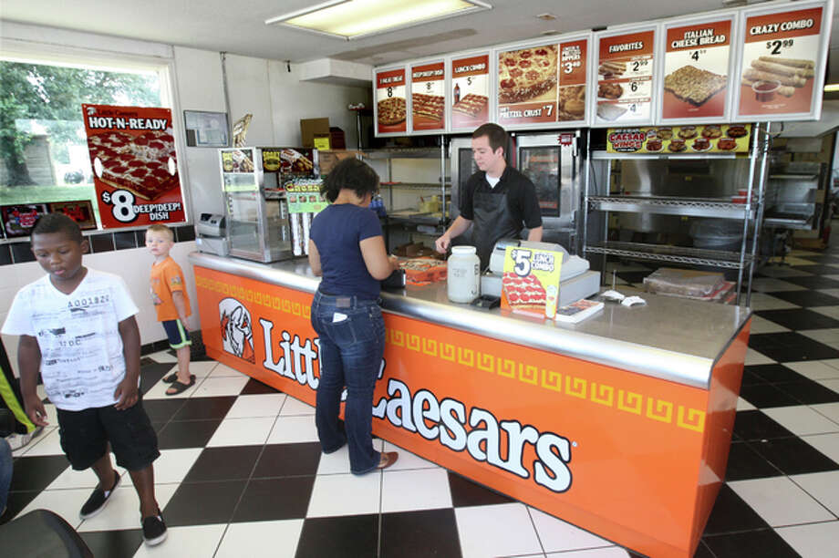 A customer places her order at Doyle Beck's Little Caesars restaurant in Godfrey. Photo: John Badman | The Telegraph