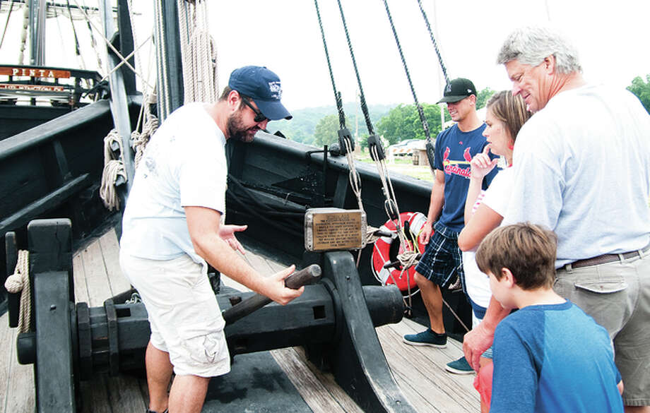 North American crew member Nikolas Kodros gives a demonstration on how an anchor is lowered and raised on the Columbus replica Nina Sunday morning. Kodros mentioned that the real Nina had a 24-man crew between the ages of 15 and 20 years old who all lived on the top deck. They housed all their supplies on the lower deck, including chickens, goats and pigs. Photo: Dan Cruz | For The Telegraph