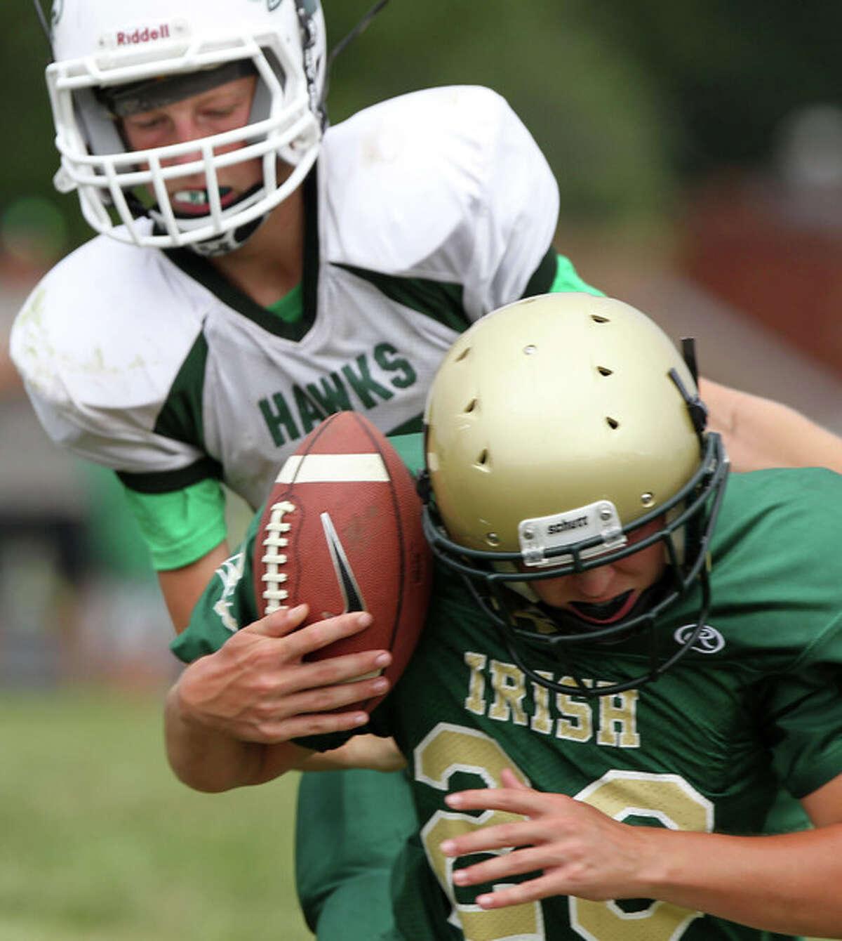 Jason Birdsell of the Junior Irish football team intercepts a pass during a game against Carrollton Saturday at Virginia.