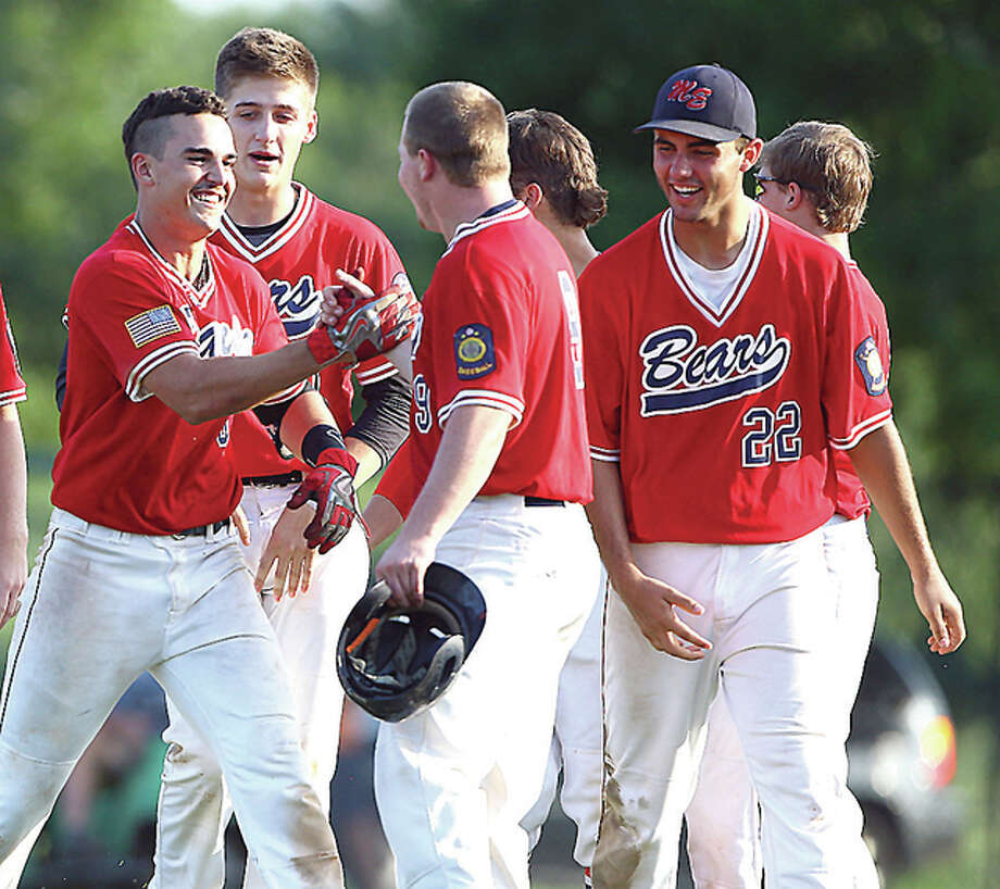 Metro East's Drake Hampton (left) celebrates with teammates after hitting a game-winning single against Plover, Wisconsin during the Great Lakes Regional Tournament. Photo: Billy Hurst | For The Telegraph