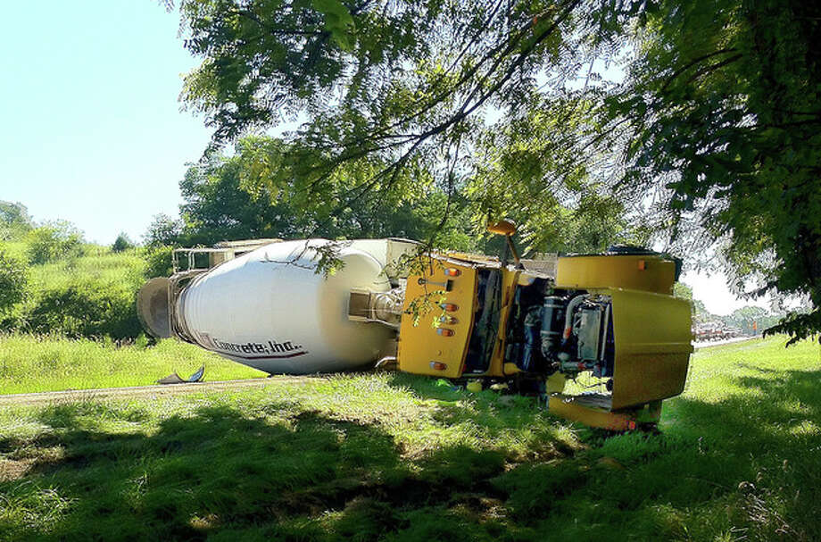 A Jacksonville man was injured Tuesday when his cement mixer overturned in Cass County. Joshua J. Bruns, 38, of Jacksonville was taken to St. John's Hospital in Springfield after his truck went off the road on Illinois Route 125 near Schall Road and he over-corrected, which caused it to roll onto its side, according to Illinois State Police. Photo: Robert Daniel | Journal-Courier