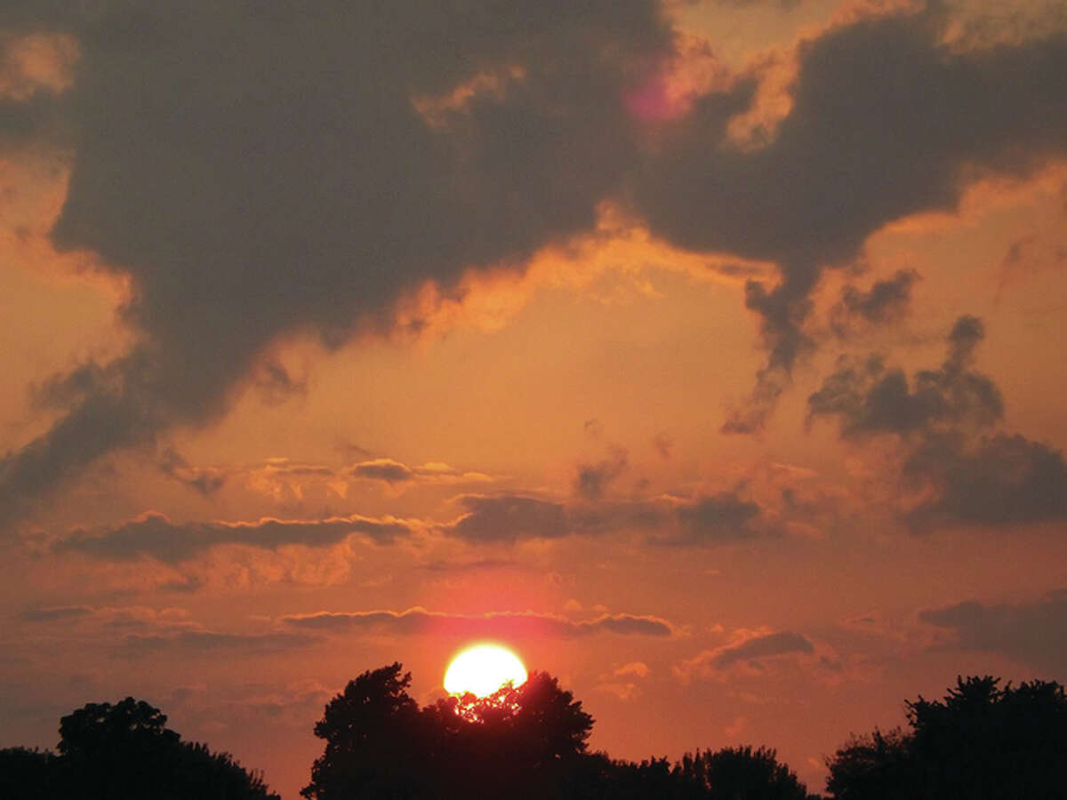The setting sun paints the skies over west-central Illinois a deep orange.