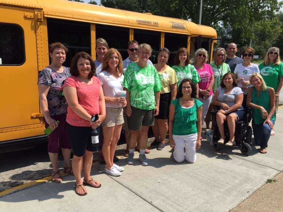 The staff of Gilson Brown before their visits to students' neighborhoods delivering school supplies.