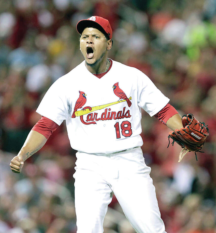 Cardinals starting pitcher Carlos Martinez reacts to striking out the Pirates' Jung Ho Kang to end the eighth inning Tuesday night at Busch Stadium. Photo: Tom Gannam | Associated Press