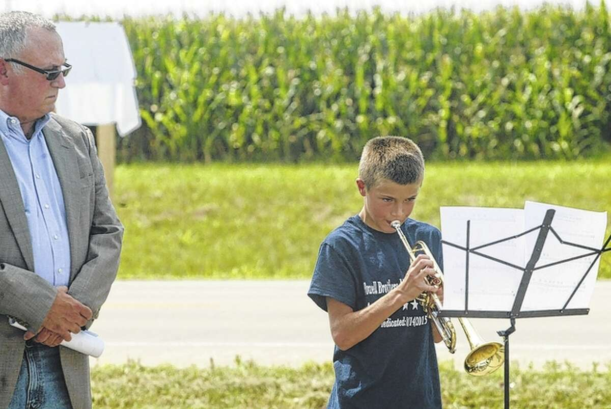 Tyler Powell, the 11-year-old grandson of Adrian Powell, plays military music Friday during a dedication of a section of U.S. 67 through Greene County in honor of Adrian Powell and his brothers, who served in various branches of the military in World War II.