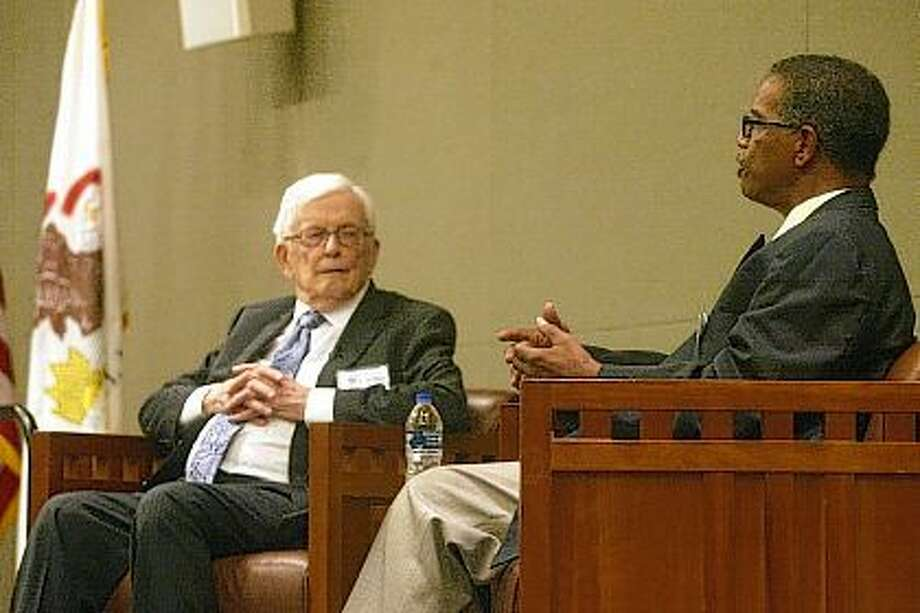 Former U.S. Rep. Paul Findley of Jacksonville (left) listens Saturday as Frank Mitchell, a former Springfield resident and the first African-American page for the U.S. House in 1965, talks about how he became a page. Findley and Mitchell reunited at the Abraham Lincoln Presidential Library in Springfield to speak about that historic event. The program was sponsored by the U.S. Capitol Page Alumni Association and moderated by Michael Esposito, a journalist with the Chicago Tribune and a former page. Photo: Greg Olson | Journal-Courier